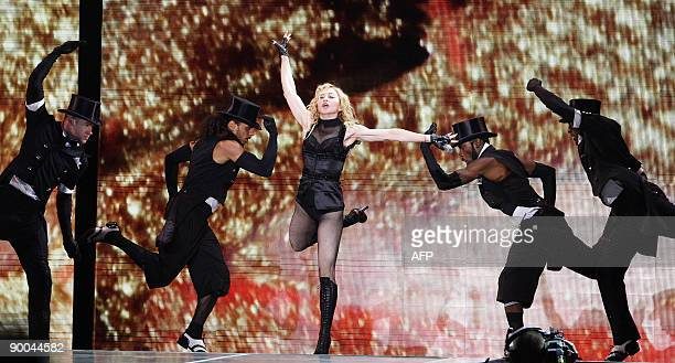 US pop diva Madonna performs on stage during her Sticky and Sweet tour concert in the Serbian capital Belgrade on August 24 2009 AFP PHOTO / MARKO...
