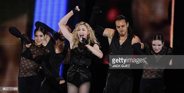 US pop diva Madonna performs on stage during her Sticky and Sweet tour concert on September 1 2009 in Tel Aviv�s Yarkon Park AFP PHOTO / JACK GUEZ