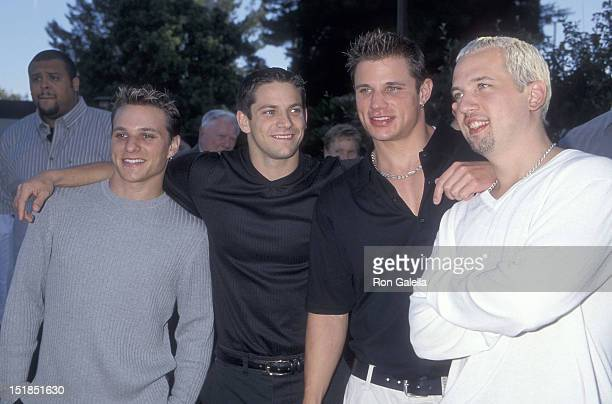 Pop group 98 Degrees Drew Lachey Jeff Timmons Nick Lachey and Justin Jeffre attend 'A Night at the Net' Tennis Tournament to Benefit MusiCares and...