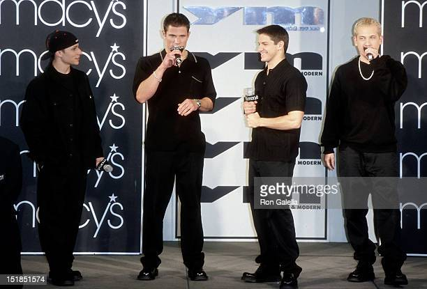 Pop group 98 Degrees Drew Lachey Nick Lachey Jeff Timmons and Justin Jeffre attend YM's Spring/Summer Fashion Show on April 20 1999 at Macy's Herald...