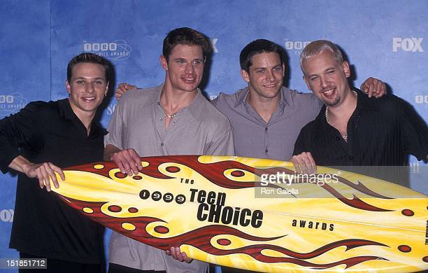 Pop group 98 Degrees Drew Lachey Nick Lachey Jeff Timmons and Justin Jeffre attend the First Annual Teen Choice Awards on August 1 1999 at the Barker...