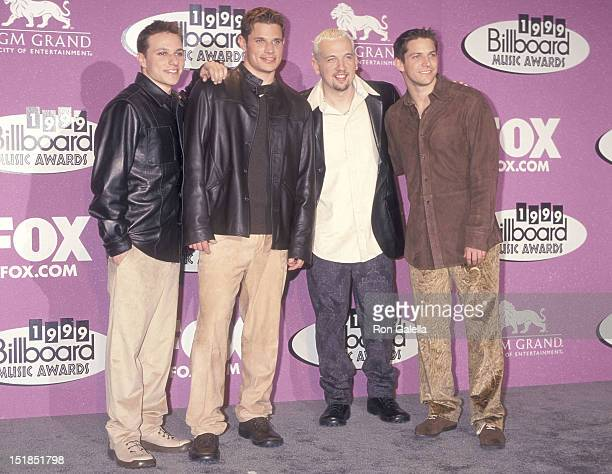 Pop group 98 Degrees Drew Lachey Nick Lachey Justin Jeffre and Jeff Timmons attend the 10th Annual Billboard Music Awards on December 8 1999 at the...