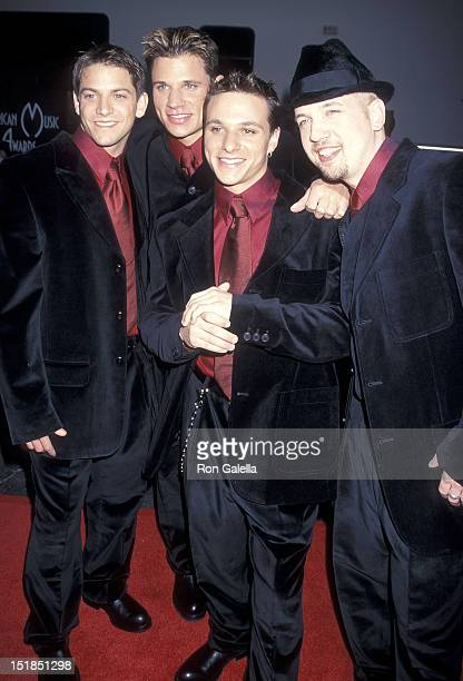 Pop group 98 Degrees Jeff Timmons Nick Lachey Drew Lachey and Justin Jeffre attend the 26th Annual American Music Awards on January 11 1999 at the...