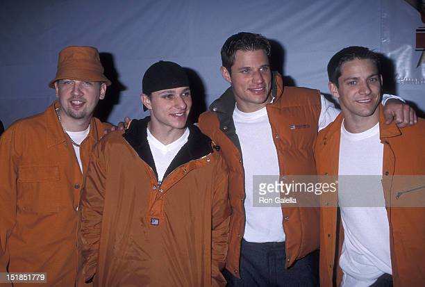 Pop group 98 Degrees Justin Jeffre Drew Lachey Nick Lachey and Justin Jeffre attend the 68th Annual Hollywood Christmas Parade on November 28 1999 at...