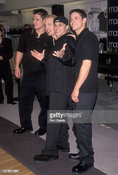 Pop group 98 Degrees Nick Lachey Justin Jeffre Drew Lachey and Jeff Timmons attend YM's Spring/Summer Fashion Show on April 20 1999 at Macy's Herald...