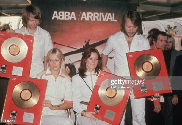 Pop group Abba holding their golden discs From l to r Benny Andersson Agnetha Faltskog AnniFrid Lyngstad and Bjorn Ulvaeus A Swedish group except for...