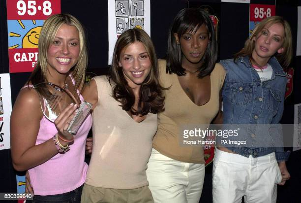 Pop group All Saints from left to right Nicole Appleton Melanie Blatt Shaznay Lewis and Natalie Appleton with their award for London's Favourite...