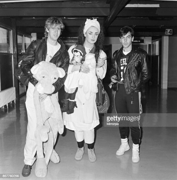 Pop group Culture Club arrive at Heathrow Airport from Madrid Pictured left to right John Suede Boy George and Jon Moss 5th November 1983