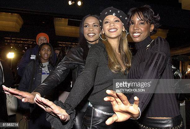 US pop group Destiny's Child Michelle Williams Biance Knowles and Kelly Rowland pose after the announcement of the nominations for the 2001 Grammy...