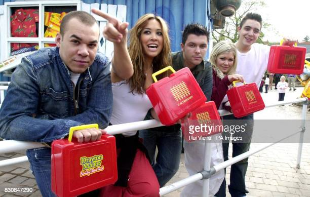 Pop group Hear'Say Danny Foster Myleene Klass Johnny Shentall Suzanne Shaw and Noel Sullivan with Budget type red boxes during their visit to Drayton...