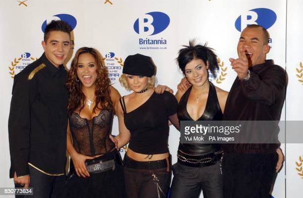 Pop group Hear'Say Noel Sullivan Myleene Klass Suzanne Shaw Kym Marsh and Danny Foster pose for the media backstage at the Britannia Record of the...