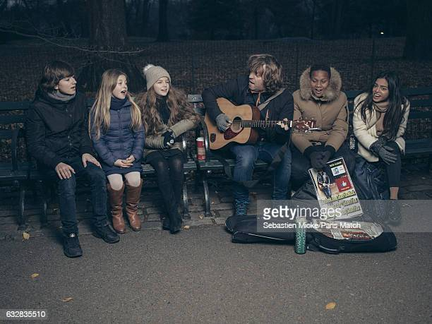 Pop group Kids United with street musician Sean Yox a street musician are photographed for Paris Match on December 11 2016 in New York City