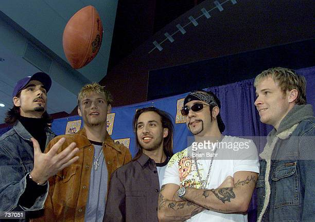 Pop group The Backstreet Boys play around with a football during a press conference for performers in the 2001 Super Bowl XXXV pregame show at...