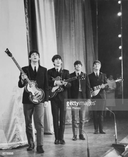 Pop group The Beatles take a bow on stage after performing in the Royal Command Performance at the Prince of Wales Theatre