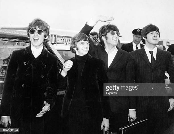 Pop group The Beatles waving to screaming fans en route to Boston airport America from left to right George Harrison Ringo Starr John Lennon and Paul...