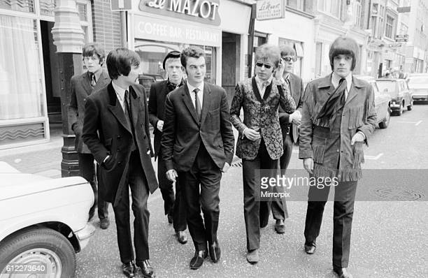 Pop group ' The Move ' with labourer Fred Lynch who found two stolen tapes and returned them to the band Seen having lunch in a Soho cafe 9th May 1967