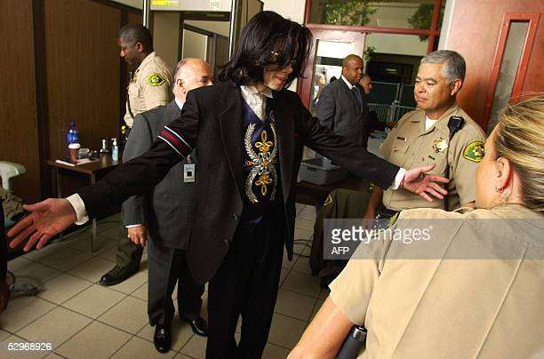 Pop icon Michael Jackson is scanned for metal objects as he arrives at the Santa Maria Courthouse for his child molestation trial 23 May 2005 in...