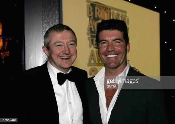 Pop Idol and X-Factor judges Simon Cowell and Louis Walsh are seen on stage at the Pioneer British Academy Television Awards 2006 at the Grosvenor...
