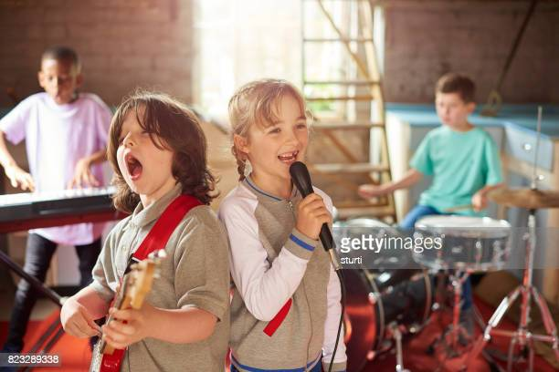 pop kids - garage band stock photos and pictures