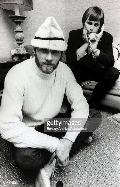 7th November 1966 Two members of the American pop group The Beach Boys famous for their surfing sounds frontMike Love and on the telephone Brian...