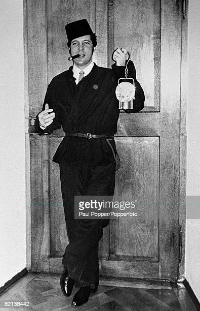January 1968 Welsh singer Tom Jones is pictured at a Berchtesgaden Germany saltmine with leather protective outfit fez style hat and lamp with his...