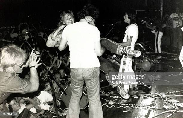 1976 Sydney Australia Chaotic scenes at a Bay City Rollers concert as a 'bouncer' carries away a crying fan