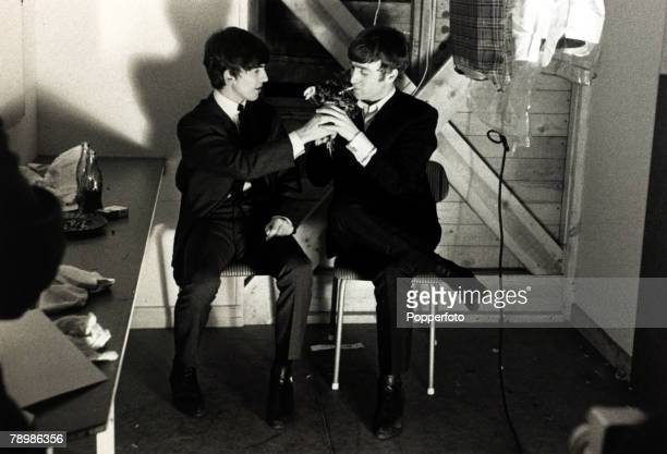Pop Music Pesonalities The Beatles October 1963 Stockholm George Harrison left and John Lennon in their dressing room prior to an appearance on...