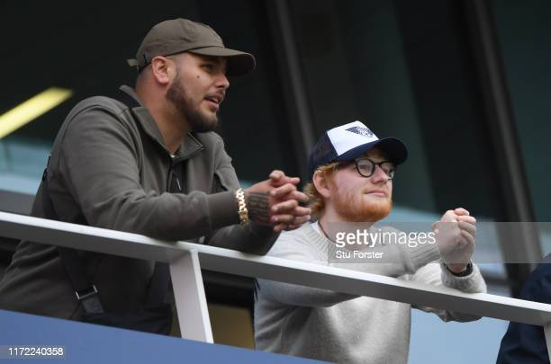 Pop Music singer songwriter Ed Sheeran looks on from the hospitality boxes during day one of the 4th Ashes Test match between England and Australia...