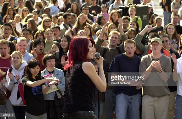 Pop music singer Tiffany performs for cheering fans November 16 2000 during a free concert at the University of California Los Angeles in Los Angeles...
