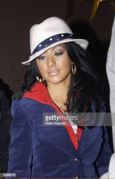 Pop music star Christina Aguilera walks out of Tao nightclub on February 19 2004 in New York