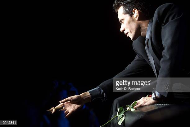 Pop performer Marc Anthony sings before a sold out crowd at New York's Madison Square Garden during his New Year's Eve show Sunday December 31 2000...
