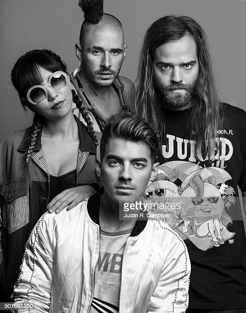 Pop rock band DNCE members Joe Jonas Jack Lawless Cole Whittle and JinJoo Lee poses for a portrait at the 2015 Jingle Ball for Just Jared on December...