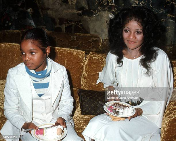 Pop singer and actress Janet Jackson and her sister LaToya Jackson pose for a portrait in circa 1978