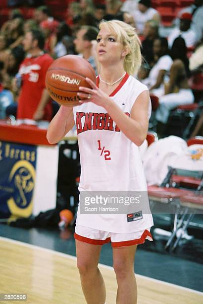 Pop singer Britney Spears shoots a basketball during warmups for NSync's Challenge for the Children III charity event July 29 2001 at the Thomas Mack...