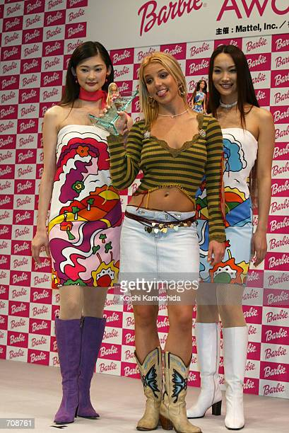 Pop singer Britney Spears smiles as she receives a Barbie award April 21 2002 in Tokyo Japan The award created by US toy maker Mattle Inc and Japans...