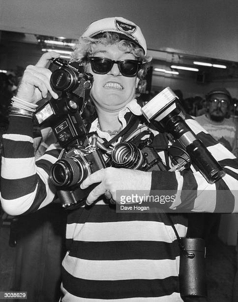 Pop singer Captain Sensible, formerly of punk group The Damned, arrives clutching several cameras, at a party given by Just 17, a magazine for...