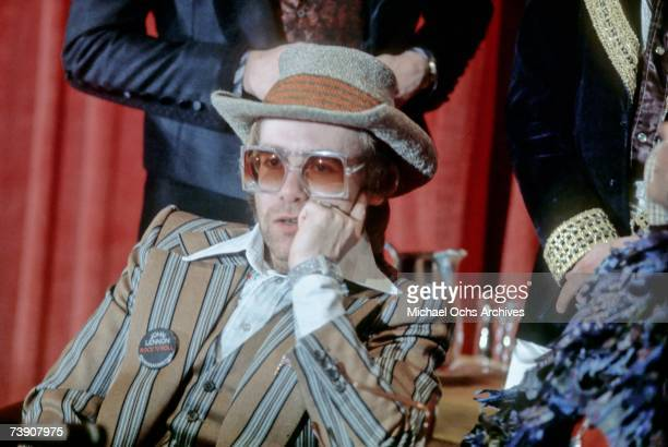 Pop singer Elton John attends a press conference for the release of the rock group The Who's rock opera film Tommy in which he appears as the Pinball...