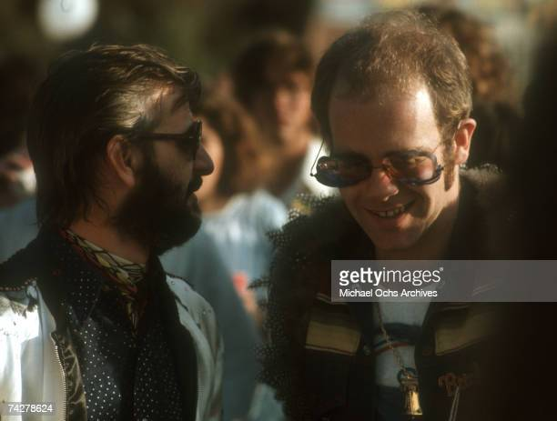 Pop singer Elton John chats with Ringo Starr at a party to celebrate the launch of the 'Elton John 1974 Tour' in 1974 in Los Angeles California