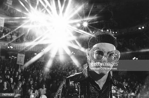 Pop singer Elton John plays the song Pinball Wizard in the rock band The Who's rock opera movie Tommy which was released on March 26 1975 in the...