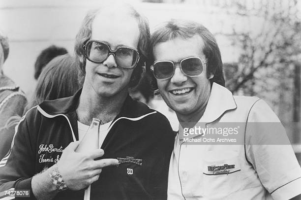 Pop singer Elton John poses for a portrait with his lyricist Bernie Taupin in circa 1974