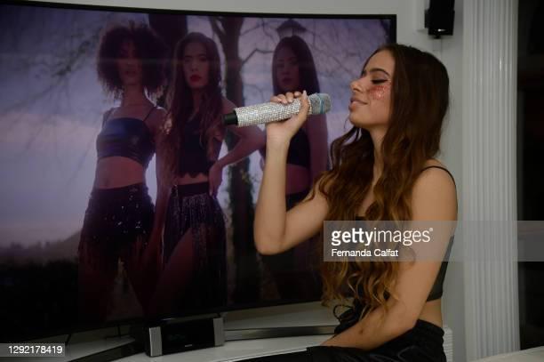 "Pop singer Emilia Pedersen watches her new music video ""Missing Myself"" on December 19, 2020 in Great Neck, New York."