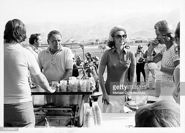 Pop singer Frank Sinatra attends the Dinah Shore Celebrity Golf Tournament with Barbara Marx, whom he would later marry, in October 1971.