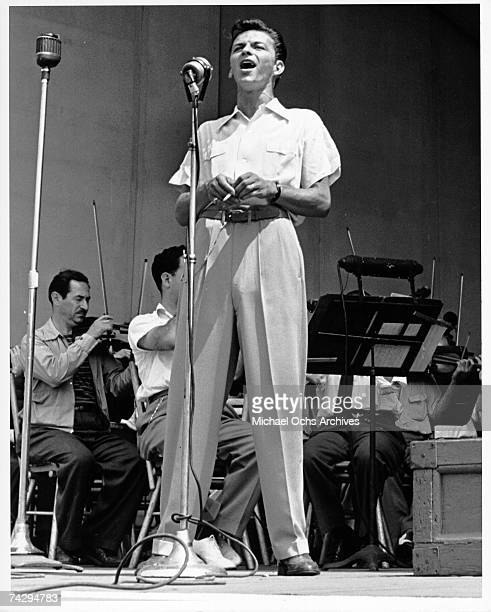 Pop singer Frank Sinatra performs onstage during a soundcheck with the Max Steiner orchestra at the Lewisohn Stadium on August 3, 1943 in New York...