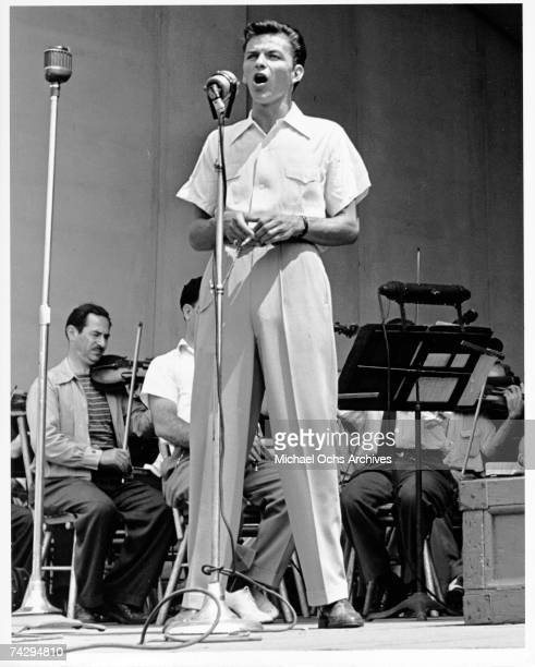 Pop singer Frank Sinatra performs onstage during a soundcheck with the Max Steiner orchestra at the Lewisohn Stadium on August 3 1943 in New York...