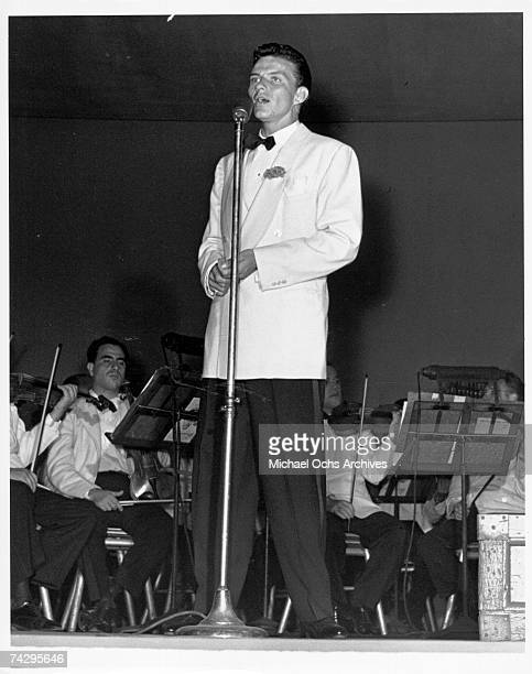Pop singer Frank Sinatra performs onstage with Max Steiner conducting the orchestra at Lewisohn Stadium on August 3 1943 in New York City New York