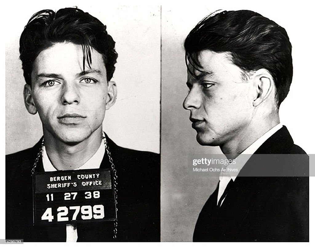 Pop singer Frank Sinatra poses for a mug shot after being arrested and charged with 'carrying on with a married woman' in 1938 in Bergen County, New Jersey.