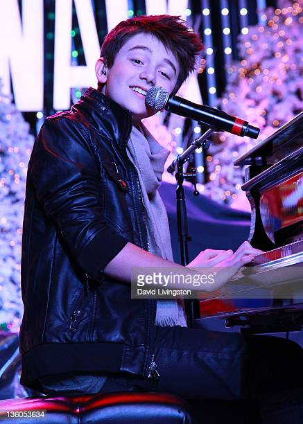 Pop singer Greyson Chance performs on stage at The Salvation Army's 2nd annual Rock the Red Kettle event at Universal CityWalk on December 17 2011 in...