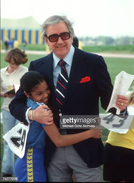 Pop singer Janet Jackson chats with talk show host sidekick Ed McMahon on set of the first episode of 'The Rock N' Roll Sports Classic' which aired...