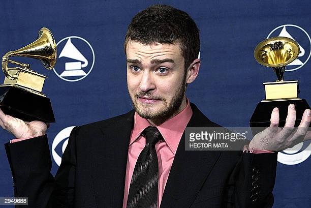 Pop singer Justin Timberlake holds his trophies for Best Male Pop Vocal Performance and Best Pop Vocal Album during the 46th Annual Grammy Awards 08...