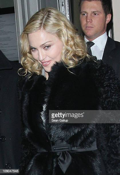 Pop Singer Madonna exits the Brasserie Restaurant during day four of the 61st Berlin International Film Festival on February 13, 2011 in Berlin,...